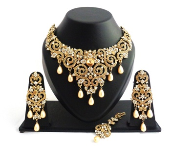 Designer golden white stone wedding necklace set with maang tikka