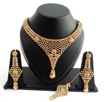 Designer golden stone necklace set with maang tikka