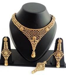 Buy Designer golden stone necklace set with maang tikka necklace-set online