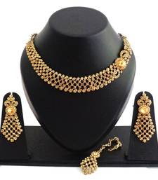 Designer golden stone necklace set with maang tikka