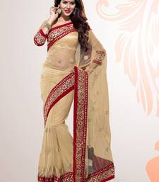 Buy Beige Embroidered Net Party Wear Saree With Blouse net-saree online