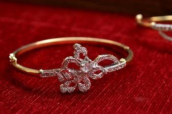 Gold stone bangles and bracelets