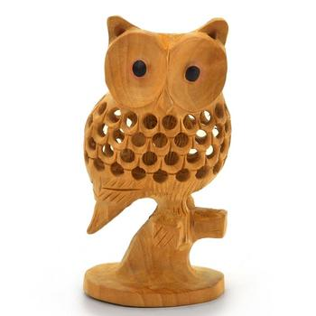 Good luck sign wooden owl sitting tree branch