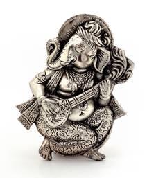 Oxidized white metal lord ganesha sitar idol