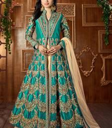 Buy Dark green embroidered art silk semi stitched salwar with dupatta silk-salwar-kameez online