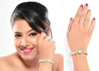 Trendy Austrian Stone Occasion Wear Stone With Pearl Gold Finishing Bracelet