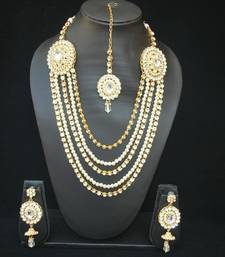 Multi layer Bridal Jewellery set Studded with White Stones and Pearls (4 Pieces)