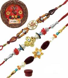 Buy Fascinating bhaiya rakhi of three with designer thali bhaiya-bhabhi-rakhi online