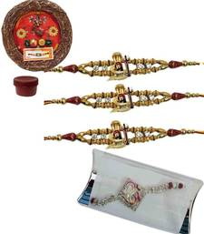 Buy Breathtaking of four auspicious and bracelet rakhis with designer thali bracelet-rakhi online