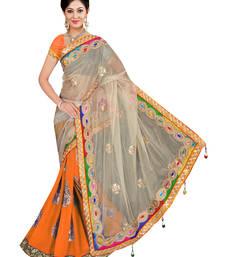 Buy Orange embroidered net saree with blouse half-saree online