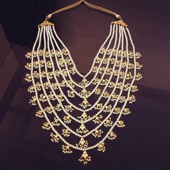 Gold plated shell pearl 7 line kundan satlada rani haar necklace