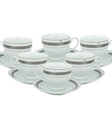 Buy White and silver tea cup saucer set in porcelain for serving tea tea-kettle online