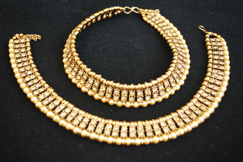Reeti Fashions - Elegant Gold studded Stones with yellow Pearls anklets