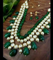 Buy Kundan and Pearls Necklace Set with Green Tumble gemstones necklace-set online