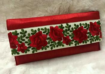 Red silk embroidered clutches