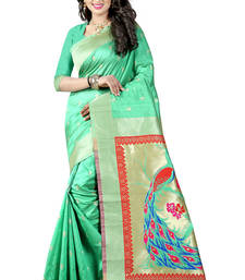 Sea green woven paithani art silk saree with blouse