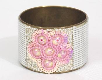 Beautiful Crafted Pink And White colored Hand Cuff