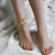 Gold Chains And Pearl Studded Ankle Bracelet