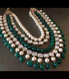 Buy Kundan and Shell Pearls Necklace Embellished with Emerald Green Onyx Stones Necklace online