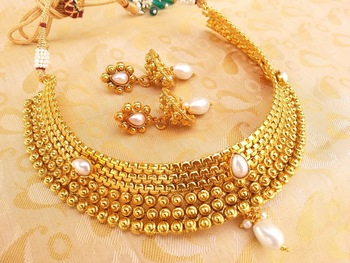 Mesmerizing White Kemp Metallic Necklace set with Jhumkas