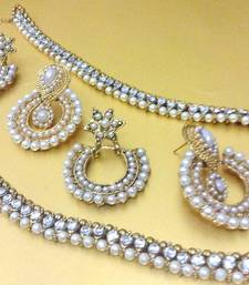 Buy Combination of white diamentes payal with two pearl earrings.  anklet online