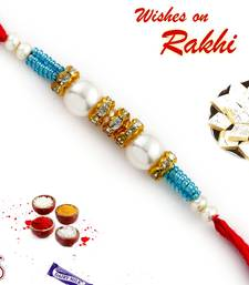 Buy Pearl Rakhi with American diamonds and Turquoise Beads pearl-rakhi-design online