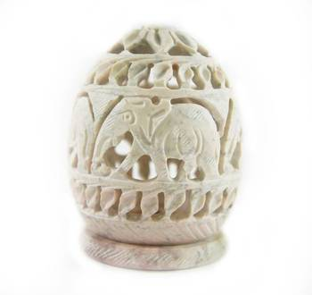 Oval carved stone candle holder (elephant design)