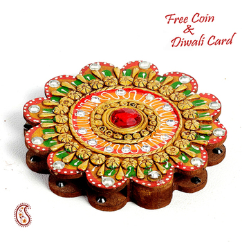 Floral design Kumkum Chopra made in wood and clay - Diwali decoration ideas