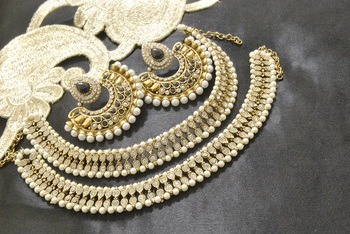 Bollywood  Earrings with Black colour stones & White colour Anklets