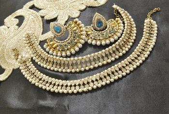 Bollywood  Earrings with Rama Green colour stones & White colour Anklets