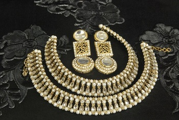 Gold Plated Handcrafted White colour Earrings &  Anklets with Pearl & Kundan