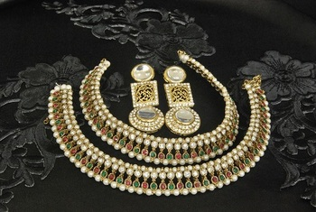 Gold Plated Handcrafted White colour Earrings & Maroon & Green colour Anklets with Pearl