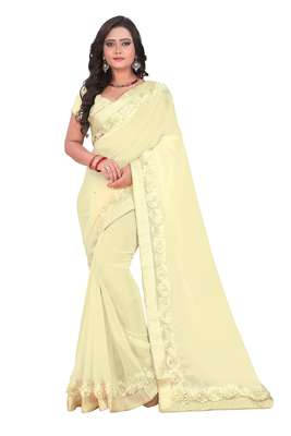 Cream woven georgette saree with blouse