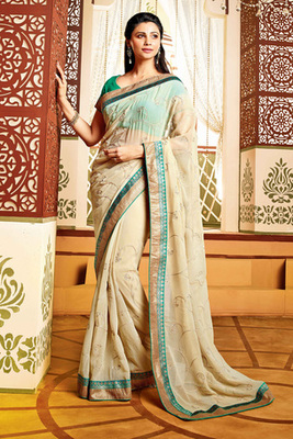 Daisy Shah Cream Georgette Saree Comprising Zari Work with Green Art Silk Blouse Piece