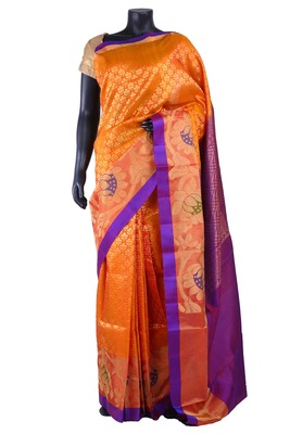 Orange silk zari woven party wear saree with purple pallu & border - SR5147