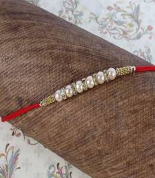 Buy Diamond Ring with Pearl Beads Rakhi pearl-rakhi-design online