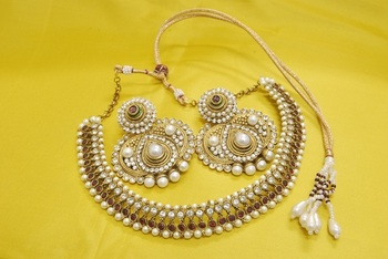JevantaBai's Traditional Maroon colour Necklace with Ruby & Pearl Earrings