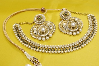 JevantaBai's Traditional Black colour Necklace with Ruby & Pearl Earrings