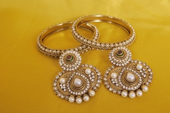 JevantaBai's Traditional Pearl Earings & Gold Plated Bangles