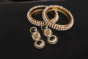 Gold Plated Handcrafted Black Colour Earrings & Pearl Bangles