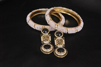 Gold Plated Handcrafted Black colour Earrings with White colour Bead Bangles set