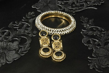 Gold Plated Handcrafted Black Colour Earrings & Stone studded Kada