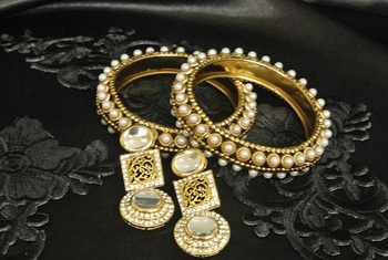 Gold Plated Handcrafted Kundan Earrings & Gold Plated Bangles