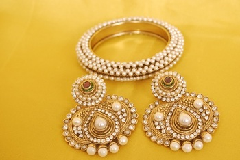 JevantaBai's Traditional Pearl Earings & Gold Plated Kada studded with Pearl