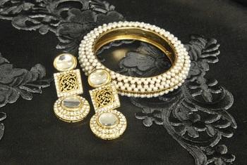 Gold Plated Handcrafted Kundan Earrings & Moti studded Kada