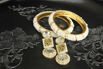 Gold Plated Handcrafted Kundan Earrings with White colour Bead Bangles set