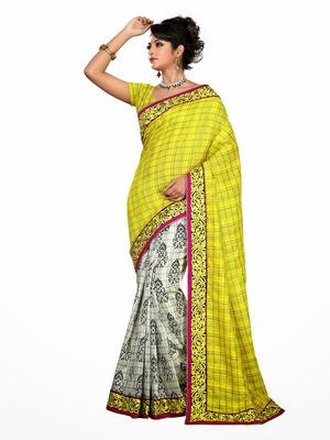 Style Yellow half and white half printed saree.