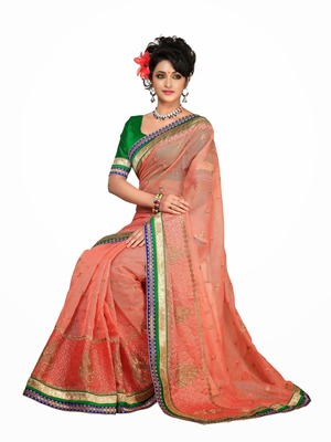 Style Peach colored  Royal brasso and plain net saree.