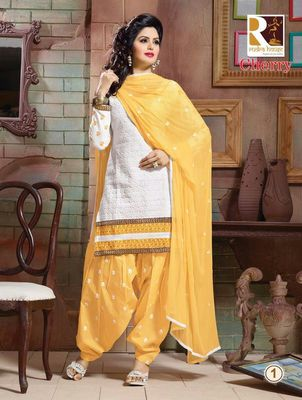 heavy embroidery.yellow white salwar suit