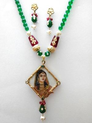 figure pendant emerald necklace